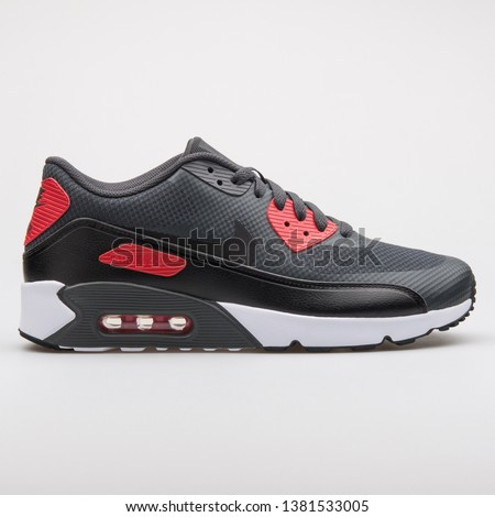 89d53bc8 VIENNA, AUSTRIA - AUGUST 7, 2017: Nike Air Max 90 Ultra 2.0 Essential black  and red sneaker on white background. - Image