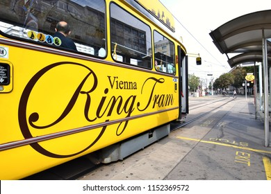"VIENNA, AUSTRIA - AUGUST 8, 2018: Nostalgic yellow ""Vienna Ring Tram"", a touristic tram line at Vienna city center"