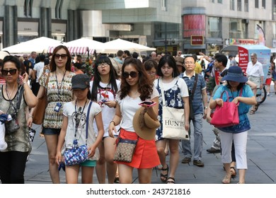 VIENNA, AUSTRIA - AVGUST 10, 2014: Tourists enjoy the pedestrian zone in the city centre in Vienna in summer. Tourism forms an important part of Austria's economy.