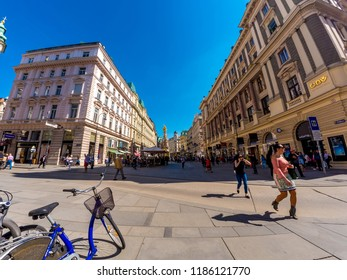 VIENNA, AUSTRIA - CIRCA APRIL 2018: View of pedestrians as they pass by on the walking street in the historic centre of the city on a sunny day circa April 2018 in Vienna, Austria