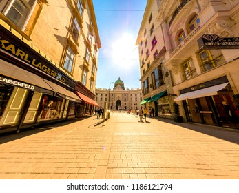 VIENNA, AUSTRIA - CIRCA APRIL 2018: View of pedestrians as they pass by in the historic centre of the city on a sunny day circa April 2018 in Vienna, Austria