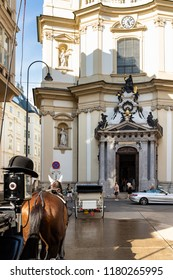 Vienna, AUSTRIA: Circa July 2018: Horse and carriage in Vienna, Austria.St. Stephen's Cathedral in the background.