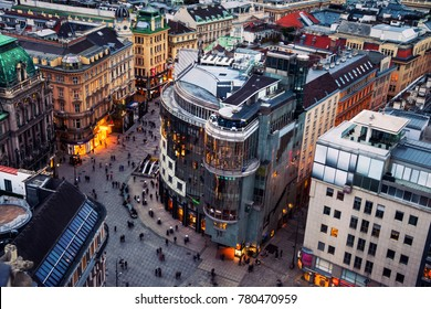 Vienna, Austria.  Crowd of people at the Stephansplatz in Vienna, Austria. Aerial night view of famous landmark with many shops, restaurants, bars and modern buildings