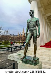 Vienna / Austria - Dec 2018: The art nouveau statue of handsome necked aryan man near Theseus Temple in Volksgarten park. Winter in Europe.