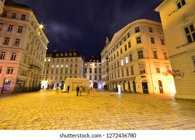 Vienna, Austria - Dec, 2018: Baroque and Wilhelminian style houses at illuminated Judenplatz with Holocaust Memorial in the old town.