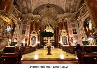 Vienna, Austria - Dec, 2018: Inside the Schottenkirche (Scots Church) Basilica Minor parish church attached to the Schottenstift, founded by Benedictine monks in the 12th century.
