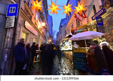 Vienna, Austria - Dec, 2018: People visit famous Christkindlmarkt Christmas fair at Spittelberg with its narrow streets between historic baroque houses of the old town in Advent.