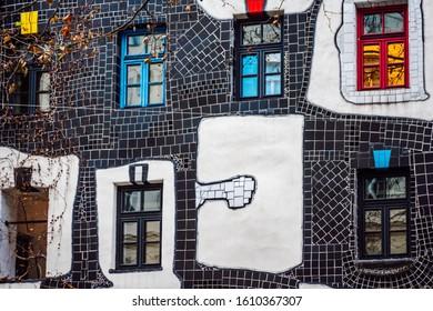 Vienna\ Austria- Dec 9, 2019 Part of the colored facade with mosaic ornaments of the Hundertwasser Museum ( Kunst Haus Wien ), Vienna, Austria.