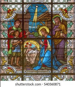 VIENNA, AUSTRIA - DECEMBER 19, 2016: The Nativity scene on the stained glass of church Mariahilfer Kirche by prof. Rudolf Geyling (1897) in workroom Carl Geylings Erben.