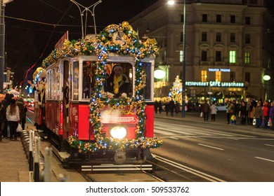 VIENNA, AUSTRIA - DECEMBER 2, 2015: Christmas Market at Rathausplatz in Vienna, Austria. Night chrismas tram