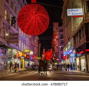 Vienna, Austria, December 2016: Christmas in Vienna; city center illuminated at Christmas time with red decorations and traditional horse carriage.