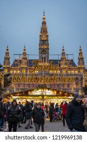 Vienna, Austria - December 2017: Christmas Market in Vienna, Austria. Text reads: Merry Christmas