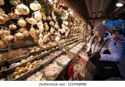 Vienna, Austria - December 2017: tourist woman looking at a shop in the main Christmas market of Vienna