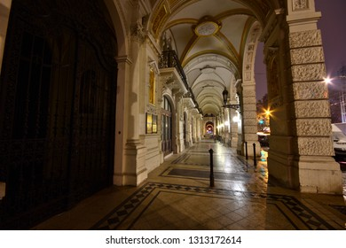 Vienna, Austria - December, 2018: Arcade passageway of Gründerzeit house in historic old town at night.
