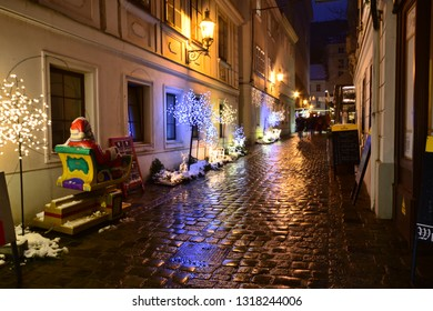 Vienna, Austria - December, 2018: Christmas atmosphere at Spittelberg with fairy lights in narrow cobblestone street between historic baroque houses of the old town in Advent.