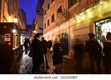 Vienna, Austria - December, 2018: People visit famous Christkindlmarkt Christmas fair at Spittelberg with its narrow streets between historic baroque houses of the old town in Advent.