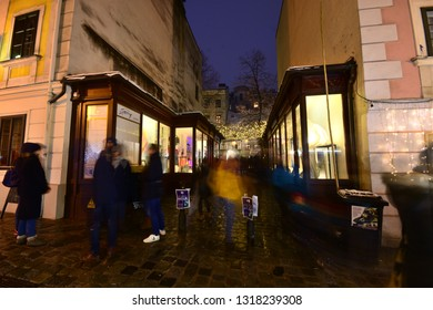 Vienna, Austria - December, 2018: Popular Christkindlmarkt Christmas market at Spittelberg with its narrow streets between historic baroque houses of the old town in Advent.