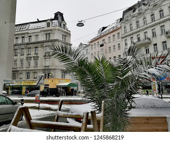 Vienna, Austria, December 2018: snow covered city street view from the 9th district