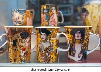 VIENNA, AUSTRIA - DECEMBER 2018: The souvenir cups printed with Gustav Klimt women portraits