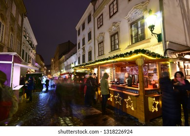 Vienna, Austria - December, 2018: Traditional Christkindlmarkt Christmas fair at Spittelberg with its narrow streets between historic baroque houses of the old town in Advent.