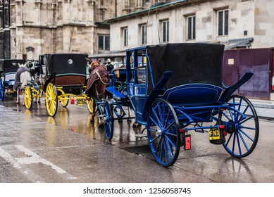 Vienna, Austria - December 21, 2017. Horse carriages parking next to St. Stephen's Cathedral. Horse-drawn fiacre with coachman is popular viennese touristic attraction.