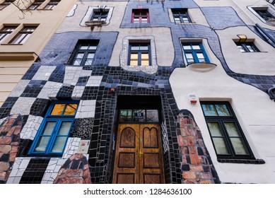 Vienna, Austria - December 27, 2017. Facade of Kunst Haus Wien museum in Landstrasse district, designed by Friedensreich Hundertwasser. Building decorated with enamelled colorful checkerboard mosaics.