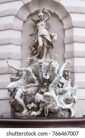 Vienna, Austria December 31, 2013: Figures on the outside of the Michaelertrakt, Hofburg, Vienna