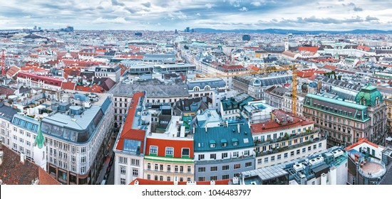 Vienna, Austria, Europe. Lovely twilight skyline view from above of Vienna. Iconic landmark and extremely popular European travel destination. View over roofs on classic architecture, dusk scenery.