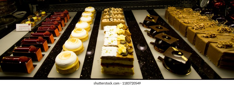 VIENNA, AUSTRIA, EUROPE - NOVEMBER 2017: Selection of desserts at a cafe in Vienna, Austria. Viennese cafe culture. Colorful desserts of different shapes.