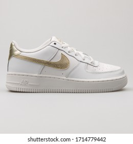 VIENNA, AUSTRIA - FEBRUARY 14, 2018: Nike Air Force 1 white and metallic gold sneaker on white background.