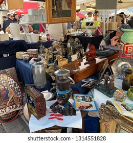 Vienna, Austria - February 16, 2018: every saturday is the biggest flea market of Vienna at the popular Naschmarkt aerea. Locals and lots of tourists are looking for bargains on this busy flea market.
