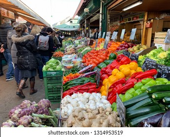 Vienna, Austria - February 17, 2019: Many Locals and Tourists visit the Naschmarkt market to relax at street restaurants and buy many different products from local producer.