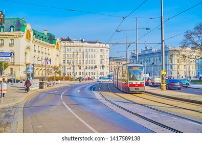 VIENNA, AUSTRIA - FEBRUARY 18, 2019: The modern tram rides along Prince Eugene street, that boasts famous edifices and landmarks, on February 18 in Vienna.