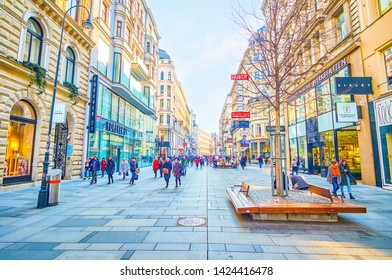 VIENNA, AUSTRIA - FEBRUARY 18, 2019: The wide Karntner street with numerous boutiques is a real heaven for shopaholics in Vienna, on February 18 in Vienna.