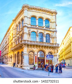 VIENNA, AUSTRIA - FEBRUARY 18, 2019: The facade of historical Ferstel Palace with rich decorative elements and famous Cafe Central on the ground floor, on February 18 in Vienna.