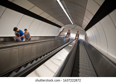 Vienna, Austria - February, 2020: People are carried up from the subway station by an escalator.