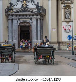 VIENNA, AUSTRIA - JANUARY 1, 2018: A coachman in a cart in the center of the city