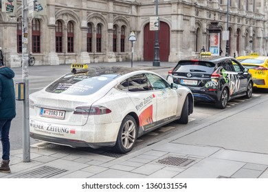 Vienna, Austria - January 15th,2019: Electric vehicles taxi Tesla model s, Nissan Leaf and Hyundai waiting for passengers in Vienna old icty center. State Opera theather on background