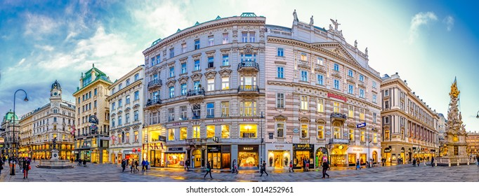 VIENNA, AUSTRIA - JANUARY 17: people in the streets in the city center of Vienna, Austria. Colorful illuminated stores, shops and restaurants at the Grabenstrasse on January 17, 2018 in Vienna,Austria