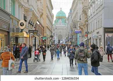 VIENNA, AUSTRIA - JANUARY 8, 2019: Kohlmarkt street with the Hofburg on the background with tourists in winter time