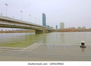 VIENNA, AUSTRIA - JANUARY 9, 2019: Danube City or Donaustadt is district of Vienna, Austria. Reichsbrücke bridge with Danube City, a modern quarter with skyscrapers and business centres