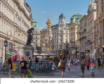 VIENNA, AUSTRIA - JUL 16: People walking Graben street in Vienna, Austria. Grabenstrasse - main shopping street old town with Plague column famous landmark place in Wien