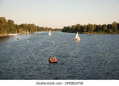 VIENNA, AUSTRIA - Jul 19, 2008: Boats on Danube river at Alte Donau in Vienna, Austria during sunset on a summer day