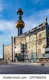 VIENNA, AUSTRIA - JUL 22, 2009:  The most famous District heating in Vienna of artist Hundertwasser in intensive afternoon light in Vienna, Austria.