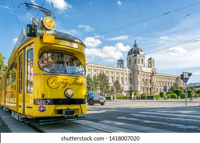 "VIENNA, AUSTRIA, JULY 1, 2016: Nostalgic yellow tram ""Vienna Ring Tram"" in front of Kunsthistorisches Museum (Art History Museum) on Ringstrasse."