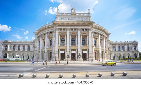 VIENNA, AUSTRIA - July 12, 2015: people and road in front of Vienna State Opera house - the Hofburg -  Historic Burgtheater (Imperial Court Theatre).It is located in centre of Vienna