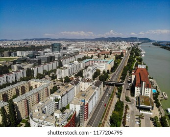 Vienna, Austria - July 12, 2018: An aerial view of the city and the Danube River, including the famous Hilton Danube Waterfront hotel in Handelskai.