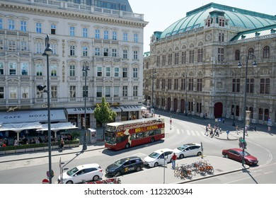 VIENNA, AUSTRIA - JULY 13, 2018: Old vintage building of tourist info in the citytown Helmut Zilk-Platz with tourist Big-Bus near the State Opera at Vienna city center Austria.