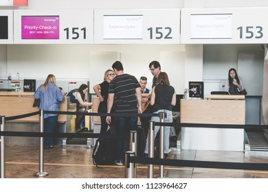 VIENNA, AUSTRIA - JULY 13, 2018: Close up of check-in area, belt control queue and tourist at international airport Vienna Austria. Queue barrier for waiting.