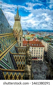 Vienna / Austria - July 13 2019: colorful view of the Stephansplatz square and tiled roofs of antique houses from the top of the spire of St. Stephen's Cathedral in Vienna, Austria